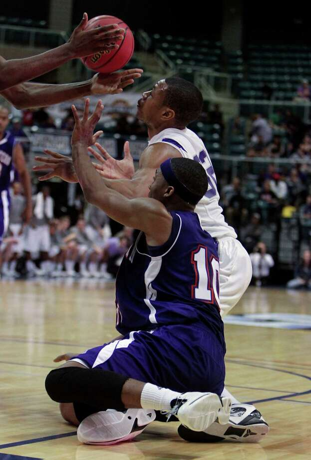 Stephen F. Austin Taylor Smith top and Northwestern State's Patrick Robinson bottom chase a loose ball during first half of the Southland Conference basketball tournament championship game at the Leonard E. Merrill Center Saturday, March 16, 2013, in Katy . Photo: James Nielsen, Houston Chronicle / © 2013 Houston Chronicle