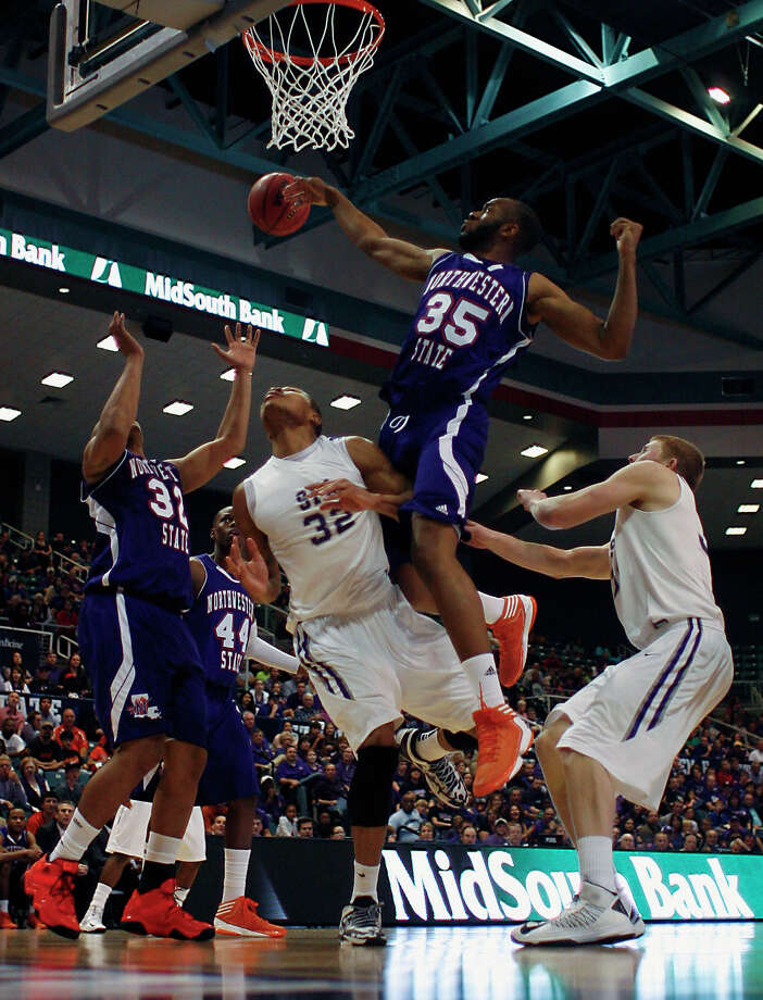 Game storyNorthwestern State's DeQuan Hicks left, Stephen F. Austin's Taylor Smith 2nd from left, Northwestern's O.J. Evans 2nd from right, and Stephen F. Austin's Thomas Walkup right, during first half of the Southland Conference basketball tournament championship game at the Leonard E. Merrill Center Saturday, March 16, 2013, in Katy . Photo: James Nielsen, Houston Chronicle / © 2013 Houston Chronicle
