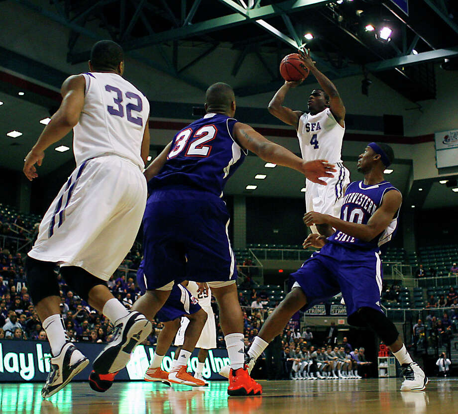 Stephen F. Austin's Taylor Smith left, Northwestern State's DeQuan Hicks 2nd from right, Stephen F. Austin's Hal Bateman 2nd from right and Northwestern's Patrick Robinson right, during first half of the Southland Conference basketball tournament championship game at the Leonard E. Merrill Center Saturday, March 16, 2013, in Katy . Photo: James Nielsen, Houston Chronicle / © 2013 Houston Chronicle
