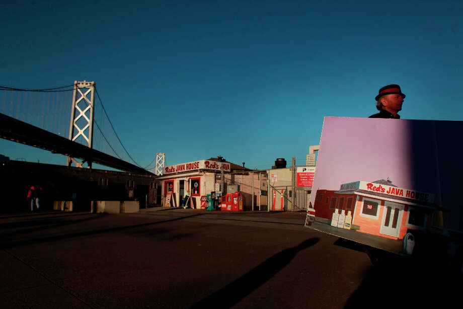 Painter Richard Louis Perri shows off his painting of Red's Java House on the Embarcadero in San Francisco, Calif. Photo: Mike Kepka, The Chronicle / ONLINE_YES
