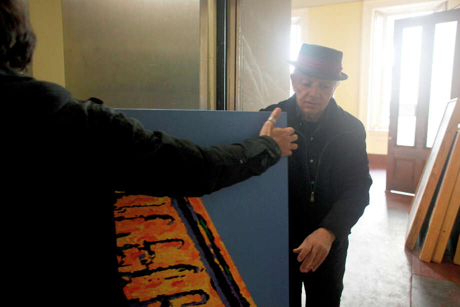 Painter Richard Louis Perri dismantles his Mid-Monument show from The Mint in San Francisco. Photo: Mike Kepka, The Chronicle / ONLINE_YES