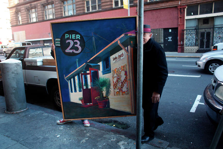 Painter Richard Louis Perri moves his Java Hut series into his studio on 7th Street in San Francisco. Photo: Mike Kepka, The Chronicle / ONLINE_YES