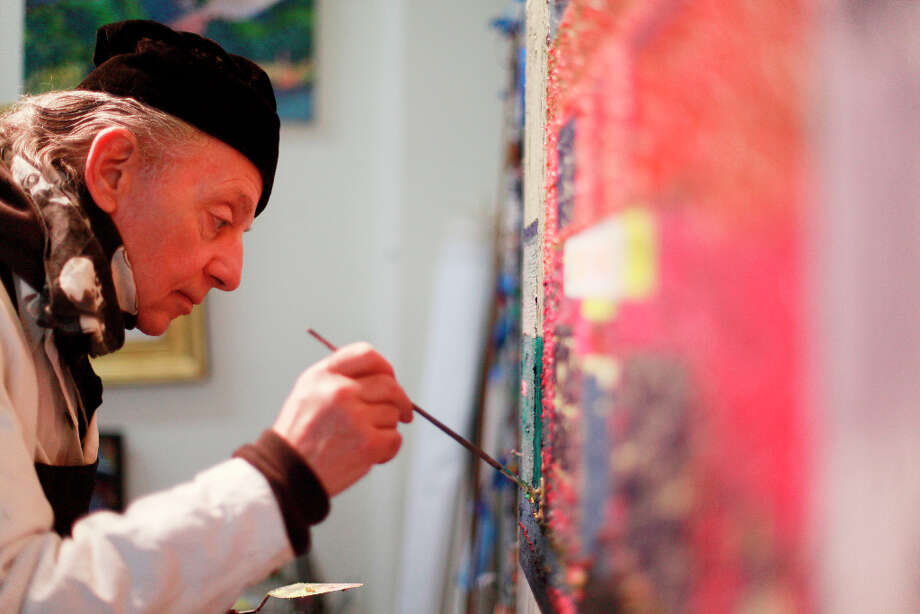 Painting in his studio, Painter Richard Louis Perri says the world melts away while he paints. Photo: Mike Kepka, The Chronicle / ONLINE_YES