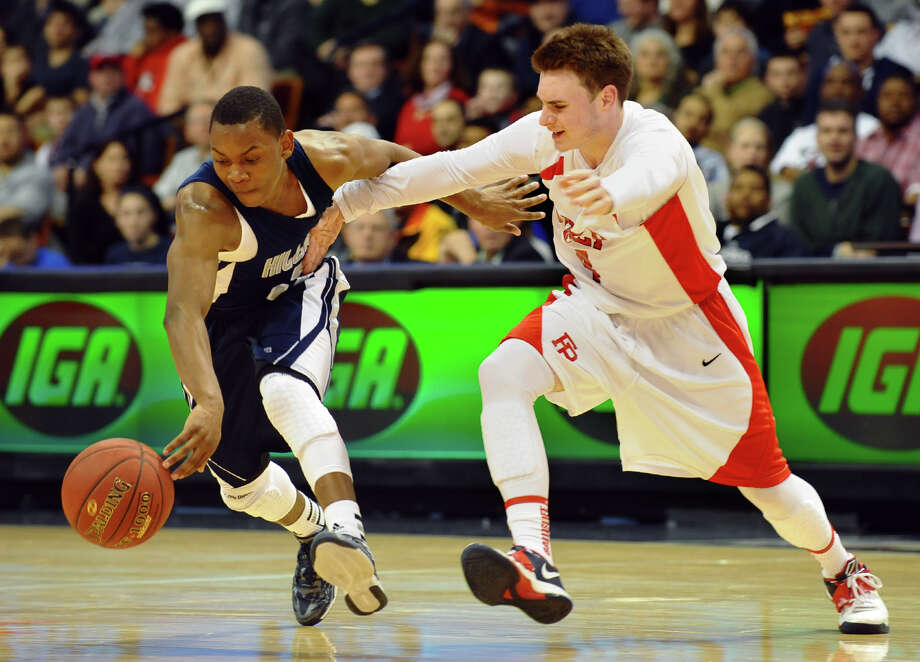 Hillhouse's #3 Bobby Bynum Jr. steals the ball away from Fairfield Prep's #4 Ryan Murphy, during Class LL boys basketball final action in Uncasville, Conn. on Saturday March 16, 2013. Photo: Christian Abraham / Connecticut Post