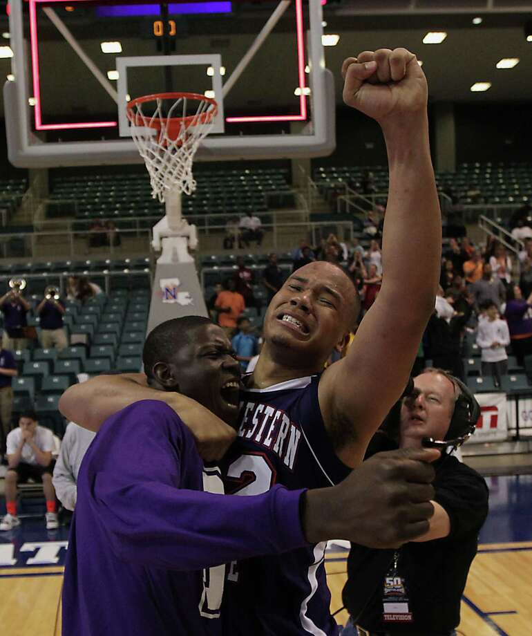 DeQuan Hicks, center, savors the moment after Northwestern State knocked off  Stephen F. Austin 68-66 to win the Southland tournament crown. Photo: James Nielsen, Staff / © 2013 Houston Chronicle