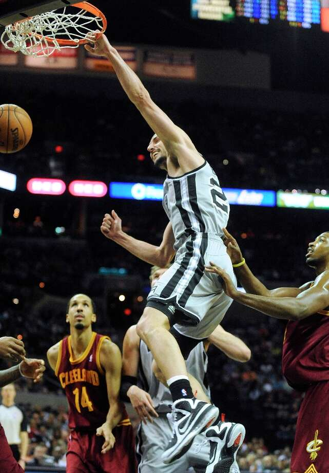 Manu Ginobiii slam dunks against the Cleveland Cavaliers during first-half action at the AT&T Center on Saturday, March 16, 2013. Photo: Billy Calzada, San Antonio Express-News / San Antonio Express-News