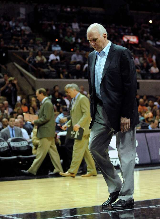 Spurs coach Gregg Popovich leaves the court after being ejected during first-half action against the Cleveland Cavaliers at the AT&T Center on Saturday, March 16, 2013. Photo: Billy Calzada, San Antonio Express-News / San Antonio Express-News