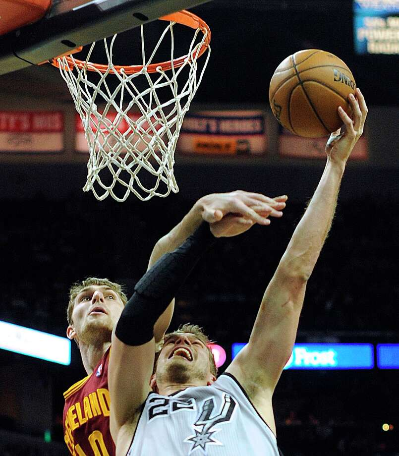 Tiago Splitter of the Spurs is fouled by Tyler Zeller of the Cleveland Cavaliers at the AT&T Center on Saturday, March 16, 2013. Splitter scored on the play and made the ensuing free throw. Photo: Billy Calzada, San Antonio Express-News / San Antonio Express-News