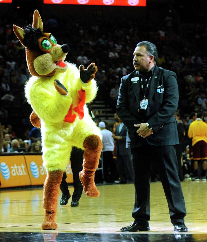 The Spurs Coyote does the chicken dance by a security officer during a timeout of the Spurs' 119-113 victory over the Cleveland Cavaliers at the AT&T Center on Saturday, March 16, 2013. Photo: Billy Calzada, San Antonio Express-News / San Antonio Express-News