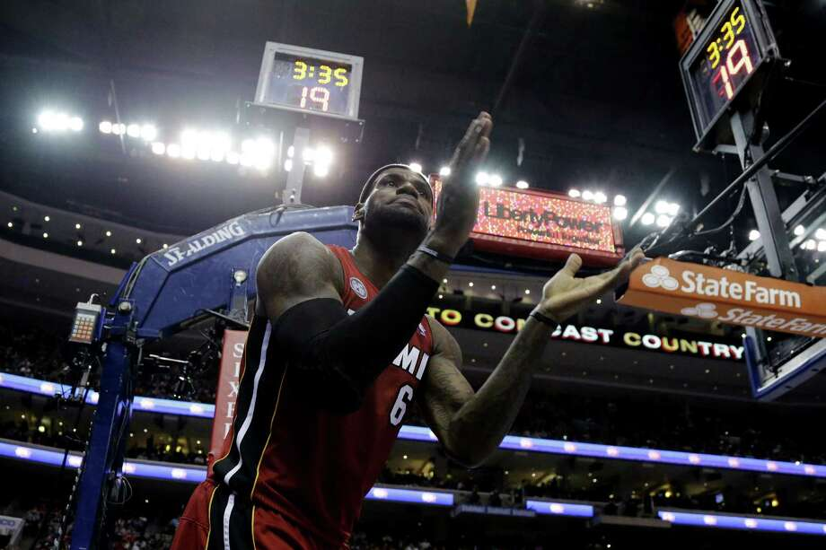 Heat forward LeBron James has his team rolling toward the Lakers' record streak of 33 straight wins set in 1972. Miami has not lost in six weeks. Photo: Matt Slocum / Associated Press