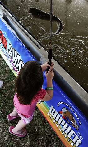 Four year old Kaitlyn Smith catches a catfish at the Kids Catch and Release Fish Tank sponsored by Gopher Industrial in Orange during the 2013 Orange County River Festival. Photo taken: Randy Edwards/The Enterprise Photo: Randy Edwards