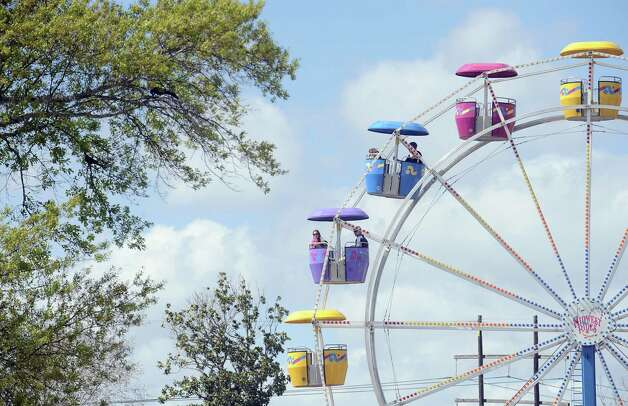 Families enjoy ferris wheel rides in Orange during the 2013 Orange County River Festival. Photo taken: Randy Edwards/The Enterprise Photo: Randy Edwards