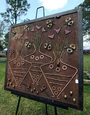 Salvaged steel sculptor Delbert Beckham shows his work at the Art in the Park event at Stark Park in Orange during the 2013 Orange County River Festival. Photo taken: Randy Edwards/The Enterprise Photo: Randy Edwards