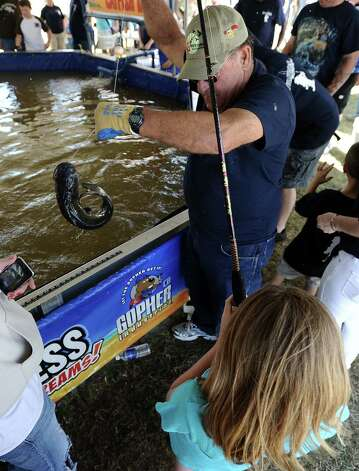 Kids Catch and Release Fish Tank sponsored by Gopher Industrial in Orange during the 2013 Orange County River Festival. Photo taken: Randy Edwards/The Enterprise