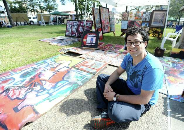 Visual artist Leonardo Castillo sets up shop at the Art in the Park event at Stark Park in Orange during the 2013 Orange County River Festival. Photo taken: Randy Edwards/The Enterprise Photo: Randy Edwards