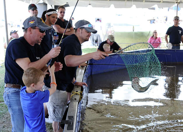 Five year old Logan Delaet catches a catfich at the Kids Catch and Release Fish Tank sponsored by Gopher Industrial in Orange during the 2013 Orange County River Festival. Photo taken: Randy Edwards/The Enterprise Photo: Randy Edwards