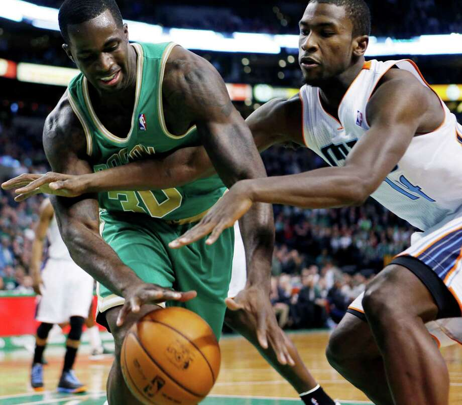 Boston Celtics' Brandon Bass (30) and Charlotte Bobcats' Michael Kidd-Gilchrist (14) battle for a loose ball in the first quarter of an NBA basketball game in Boston, Saturday, March 16, 2013. (AP Photo/Michael Dwyer) Photo: Michael Dwyer