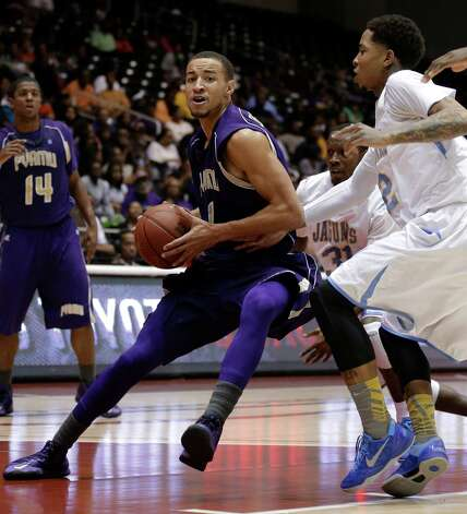 Prairie View A&M guard Jourdan DeMuynck (1) drives against Southern guard Derick Beltran, right, in the first half of an NCAA college basketball game in the championship of Southwestern Athletic Conference tournament Saturday, March 16, 2013, in Garland, Texas. Southern won 45-44. (AP Photo/Tony Gutierrez) Photo: Tony Gutierrez, Associated Press / AP