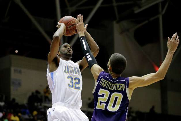 Southern's Brandon Moore (32) attempts s a shot over Prairie View A&M's Jules Montgomery (20) during an NCAA college basketball game in the championship of Southwestern Athletic Conference tournament Saturday, March 16, 2013, in Garland, Texas. (AP Photo/Tony Gutierrez) Photo: Tony Gutierrez, Associated Press / AP