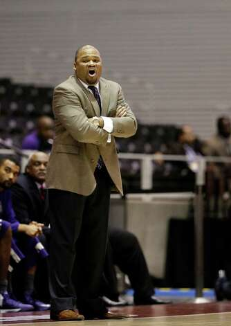 Prairie View A&M head coach Byron Rimm II instructs his team during an offensive possession in their NCAA college basketball game against Southern in the championship of Southwestern Athletic Conference tournament Saturday, March 16, 2013, in Garland, Texas. (AP Photo/Tony Gutierrez) Photo: Tony Gutierrez, Associated Press / AP