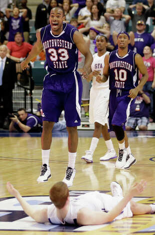 Northwestern State's James Hulbin (33) celebrates as Stephen F. Austin's Thomas Walkup lies on the  court as time expires in the Southland Conference championship basketball game on Saturday, March 16, 2013, in Katy, Texas. Northwestern State defeated Stephen F. Austin 68-66. (AP Photo/David J. Phillip) Photo: David J. Phillip, Associated Press / AP