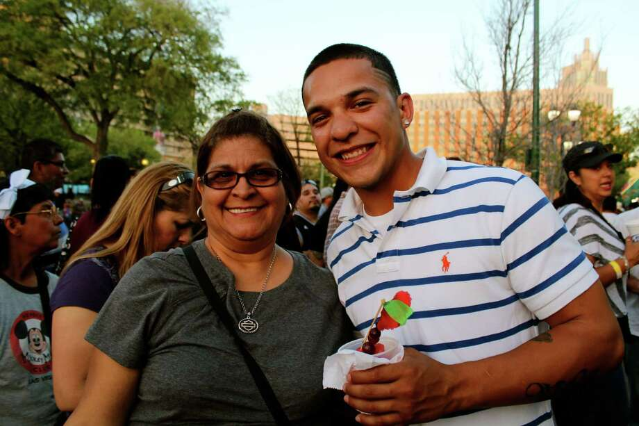 Residents take in the sights and sounds of the Tejano Music Awards' Fan Fair at El Mercado on Saturday, March 16, 2013. Photo: Yvonne Zamora, MySA.com