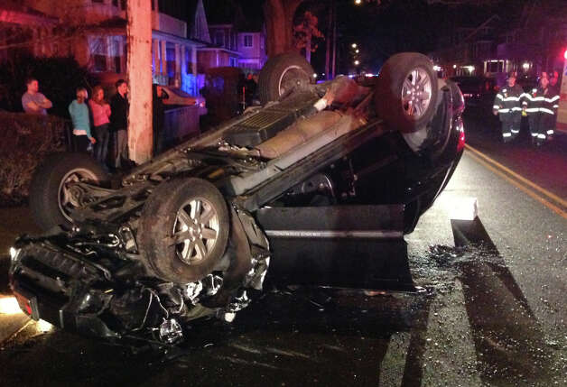 An occupant of this Jeep Cherokee was critically injured Saturday night after crashing into parked cars on Grasmere Avenue and flipping onto its roof.   FAIRFIELD CITIZEN, CT 3/16/13 Photo: Fairfield Fire Department / Fairfield Citizen contributed