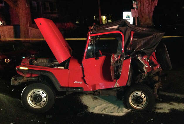 A parked Jeep Wrangler leaked gasoline after being struck late Saturday by a Jeep Cherokee that flipped onto its roof, critically injuring one of its occupants.  FAIRFIELD CITIZEN, CT 3/15/13 Photo: Fairfield Fire Department / Fairfield Citizen contributed