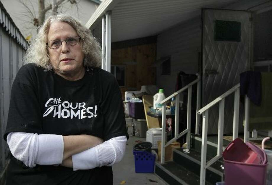 Melodie Cheney is seen outside her single-wide trailer at the Buena Vista mobile home park in Palo Alto, Calif. on Thursday, March 14, 2013. The owners of the property have applied for permission from the city to close it, sell the land to a big developer and evict the residents of the 117 homes on the site.