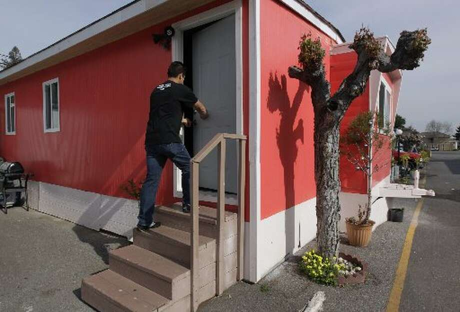 Saul Bracamontes enters his mobile home at the Buena Vista trailer park in Palo Alto, Calif. on Thursday, March 14, 2013. The owners of the property have applied for permission from the city to close it, sell the land to a big developer and evict the residents of the 117 homes on the site.