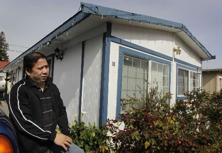 After watering the garden in front his home at the Buena Vista trailer park in Palo Alto, Calif. on Thursday, March 14, 2013, Arnold Vasco said he's concerned about his children's education if he and his family are evicted. Vasco lost his job at the Nummi car assembly plant a few years ago and relocated to Palo Alto because of its schools, and the trailer park was the only affordable option for him. The owners of the property have applied for permission from the city to close it, sell the land to a big developer and evict the residents of the 117 homes on the site.