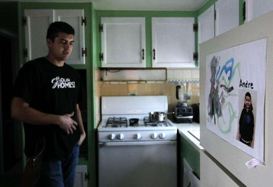 Saul Bracamontes walks through the kitchen of his trailer home, where a photo of his six-year-old son Andre hangs on the refrigerator, at the Buena Vista trailer park in Palo Alto, Calif. on Thursday, March 14, 2013. The owners of the property have applied for permission from the city to close it, sell the land to a big developer and evict the residents of the 117 homes on the site.