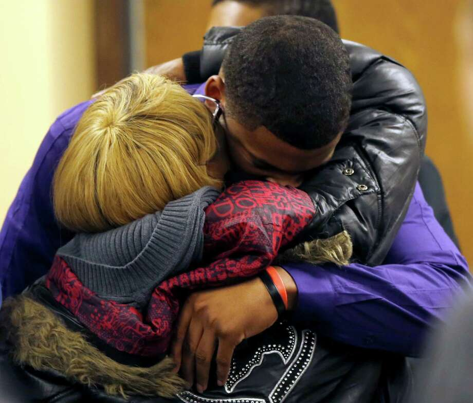 Ma'lik Richmond, 16, top, hugs his mother Daphne Birden, after closing arguments were made on the fourth day of the juvenile trial he and co-defendant Trent Mays, 17, on rape charges  in juvenile court on Saturday, March 16, 2013 in Steubenville, Ohio. Mays and Richmond are accused of raping a 16-year-old West Virginia girl in August, 2012. Judge Thomas Lipps said he would render a decision on Sunday morning, March 17. (AP Photo/Keith Srakocic, Pool) Photo: Keith Srakocic