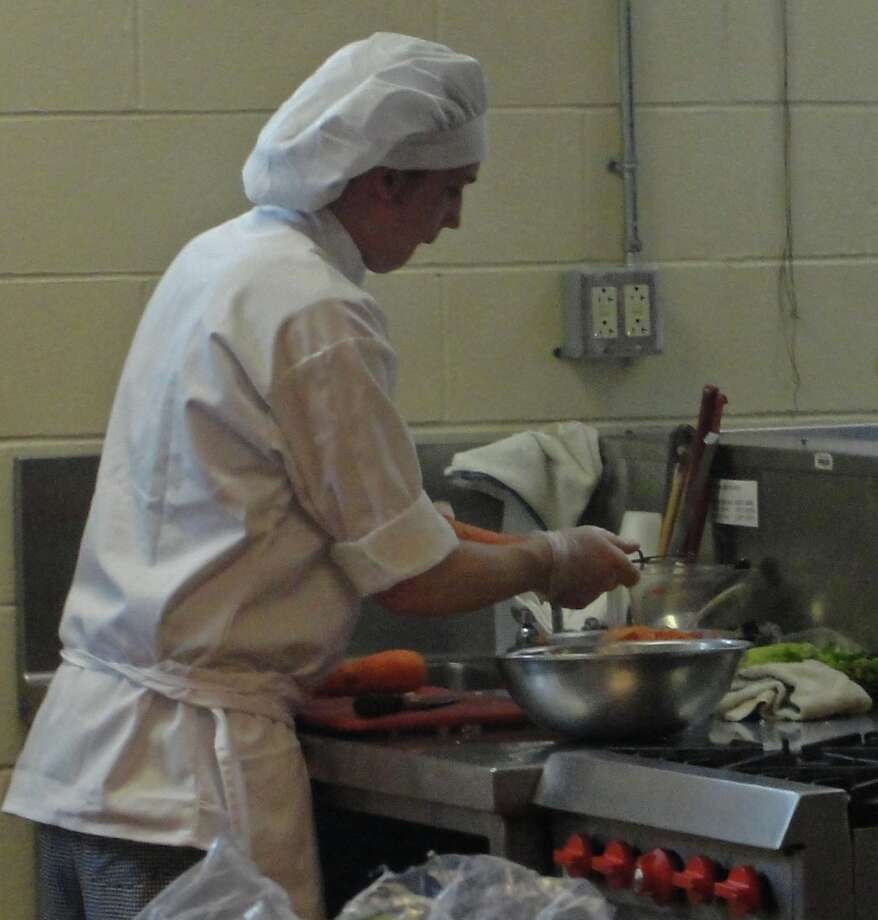 A culinary student at work. Photo by Amanda Pellegrin for New Visions: Journalism & Media Studies.