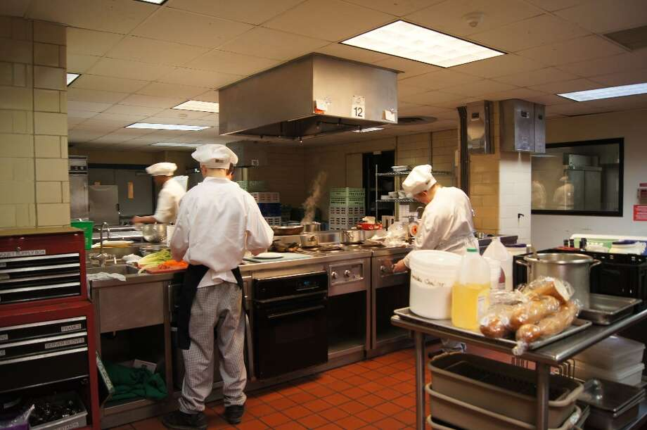 Chefs at work.Photo by Rosa D'Ambrosio for New Visions: Journalism & Media Studies.