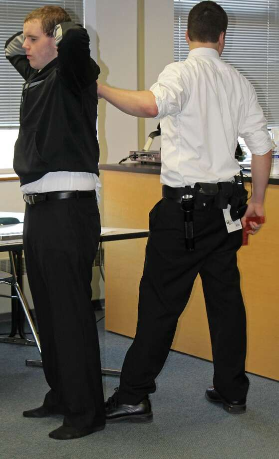 A student demonstrates proper arrest technique. Photo by Alex Luciano for New Visions: Journalism & Media Studies.
