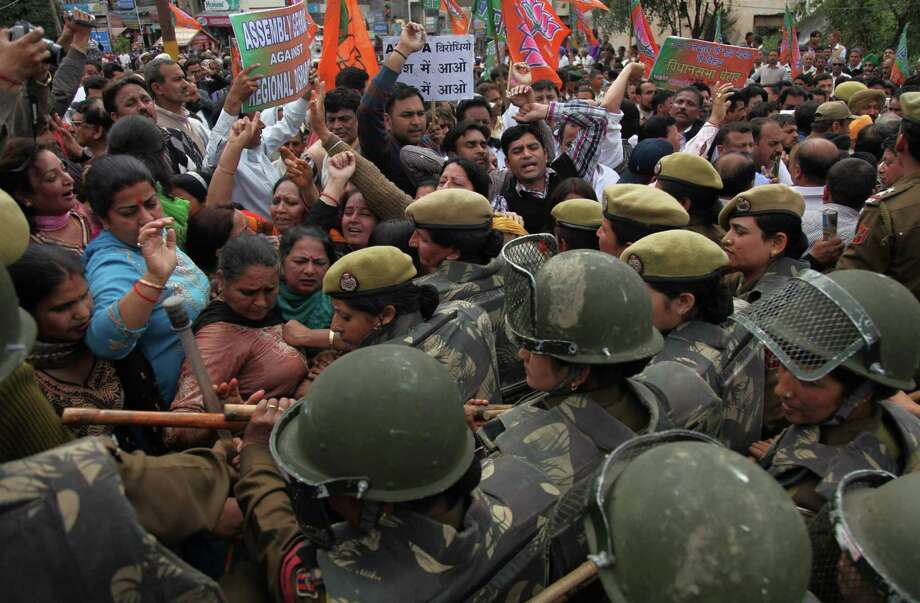 India's opposition Bharatiya Janata Party (BJP) activists scuffle with police personnel as they protest against Wednesday's militant attack in Srinagar, in Jammu, India, Thursday. Two militants carrying guns and grenades attacked a group of paramilitary soldiers on the outskirts of the capital of Indian-controlled Kashmir on Wednesday morning, leaving five soldiers and both militants dead and 10 other people wounded, police said. Opposition lawmakers accused the government of not using intelligence reports to protect the soldiers. Photo: AP