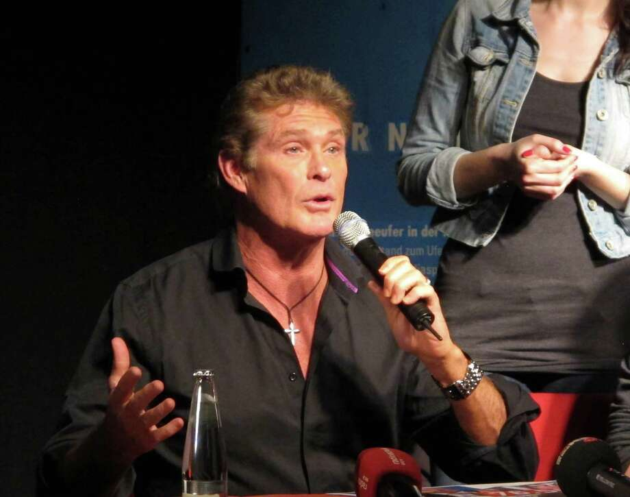 "American TV actor David Hasselhoff speaks at an event in Berlin, Germany, on Sunday protesting attempts to move one of the few remaining sections of the Berlin Wall. Hasselhoff is fondly remembered by many Germans for releasing a song called ""Looking for Freedom"" shortly before the fall of the Wall in 1989. Photo: AP"
