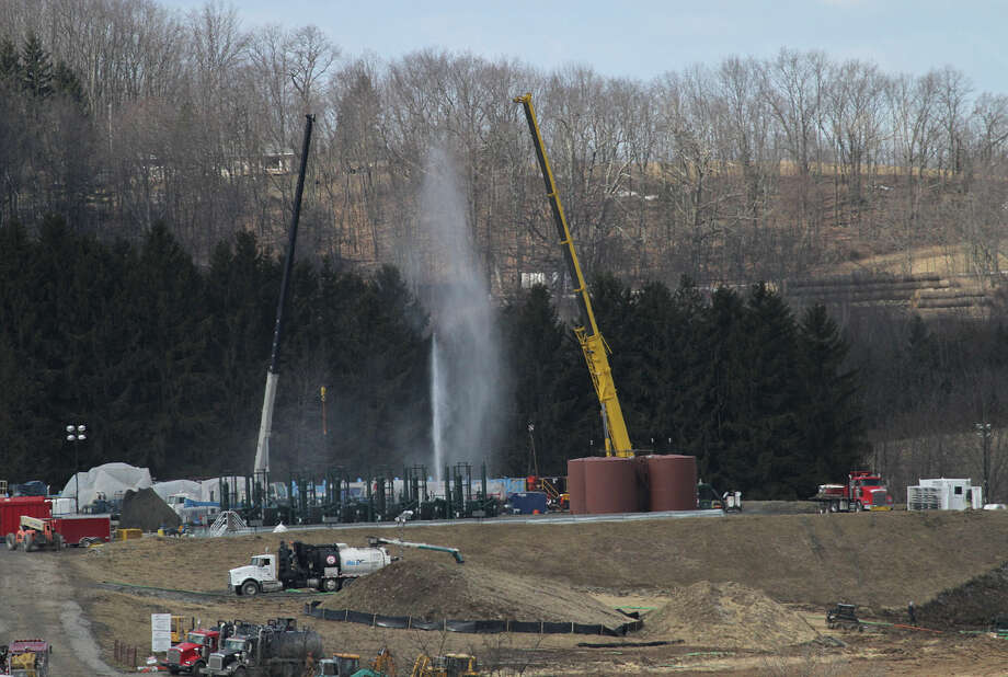 A Wyoming County, Pa., gas well malfunctions allowing wastewater to spout in to the air Thursday. Homes in the area were evacuated and Keiserville Rd. in Washington Twp., Pa., was closed as crews worked on the Marcellus Shale well on  a Carrizo Oil and Gas drilling pad.    (AP Photo/Scranton Times & Tribune, Michael J. Mullen) Photo: AP