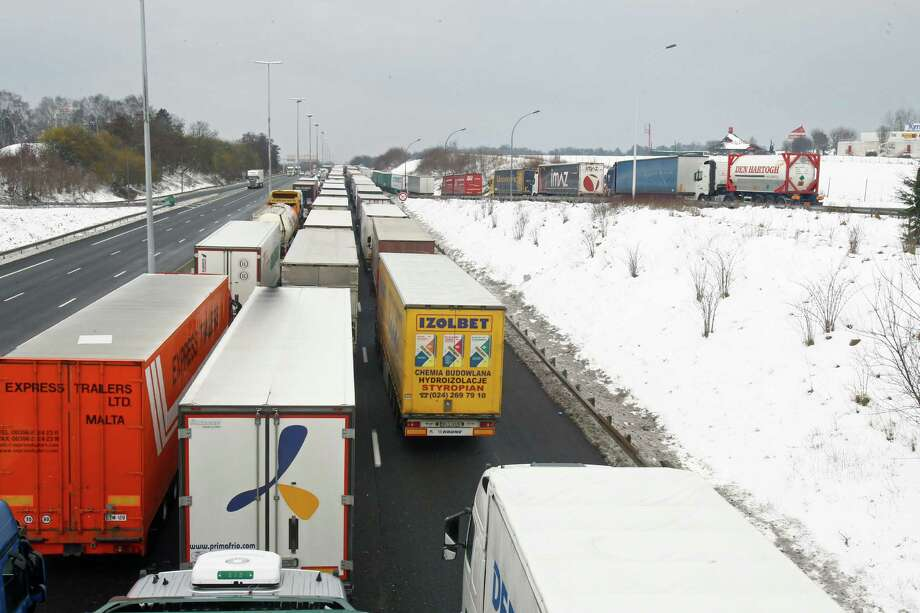 Thousands of trucks are blocked on Highway 1, bound  north, in Saint Witz, northern of France, Wednesday.  Snow and freezing temperatures continue to cause travel chaos Wednesday as some hundreds of flights in Europe have been canceled, trains are disrupted and some roads impassable. Seemingly unprepared for this heavy snow, cities across much of Europe are struggling to assure transport links. Photo: AP