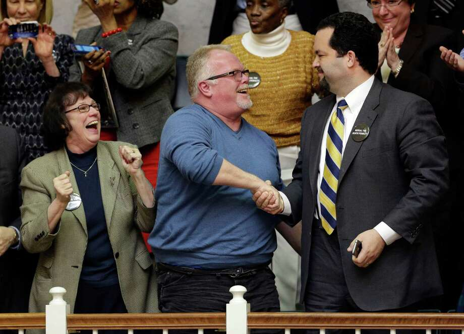 Anti-death penalty advocates Vicki Schieber, left, Kirk Bloodsworth, center, the first American sentenced to death row who was exonerated by DNA, and NAACP President Ben Jealous celebrate in the House gallery after watching the Maryland General Assembly approve a measure to ban capital punishment in Annapolis, Md., Friday. The bill now goes to Democratic Gov. Martin O'Malley, who is expected to sign it. Maryland would become the 18th state to abolish the death penalty. Photo: AP