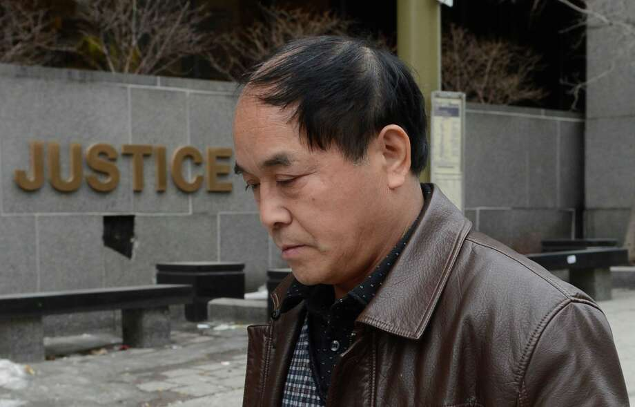 Daran Lin, father of murder victim Jun Lin, leaves court in Montreal on Monday. A preliminary hearing is set to start for Luka Magnotta, accused of dismembering his Chinese lover and mailing the body parts to political parties and schools. Photo: AP