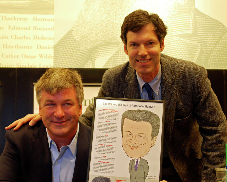"Robert Carley (right) with Alec Baldwin after he presented one of his caricatures. Carley draws famous people and puts them alongside the celebrity's well-known one-liners. Carley has also been a background actor on ""30 Rock,"" which Alec Baldwin stars in. Photo: Contributed"
