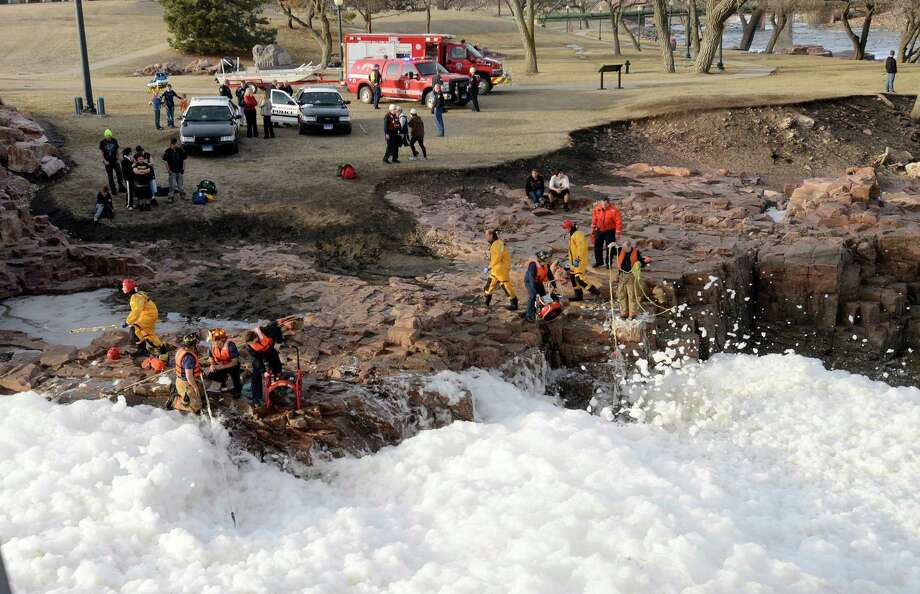 Rescuers search the Big Sioux River for two adults who went underwater after rescuing a boy who had fallen into the strong current, authorities said Thursday in Sioux Falls, S.D. (AP Photo/The Argus Leader, Elisha Page) Photo: AP