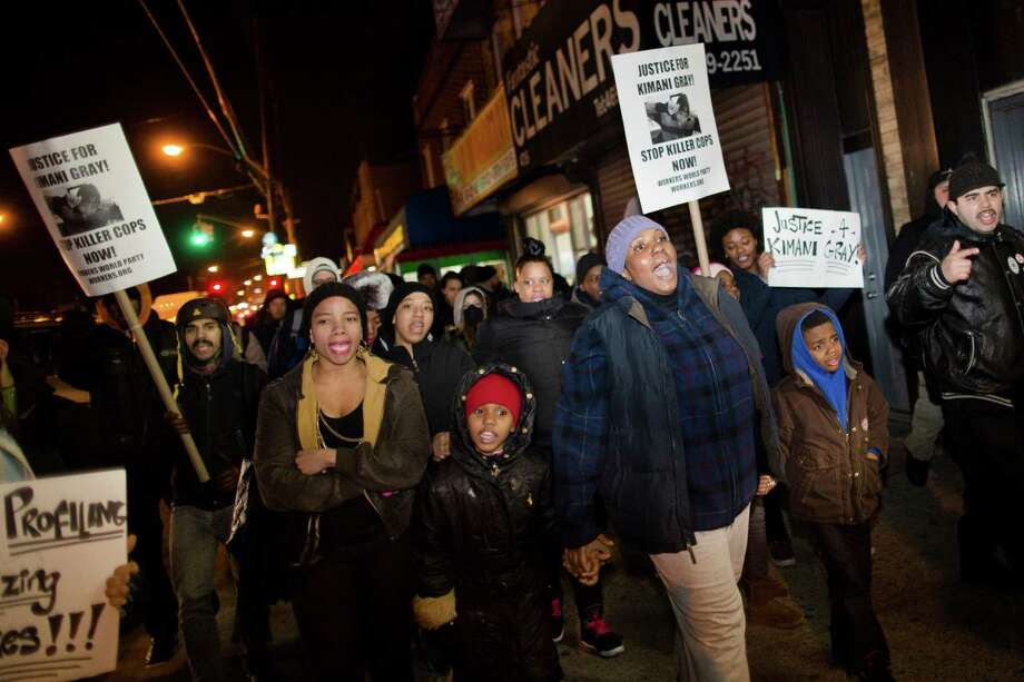 "Demonstrators march through East Flatbush as they protest against the shooting of Kimani ""Kiki"" Gray on Thursday in the East Flatbush neighborhood of Brooklyn, N.Y. The 16-year-old was shot to death on a Brooklyn street last Saturday night by plainclothes police officers who claim the youth pointed a .38-caliber revolver at them, while the family says Gray was unarmed. Photo: AP"