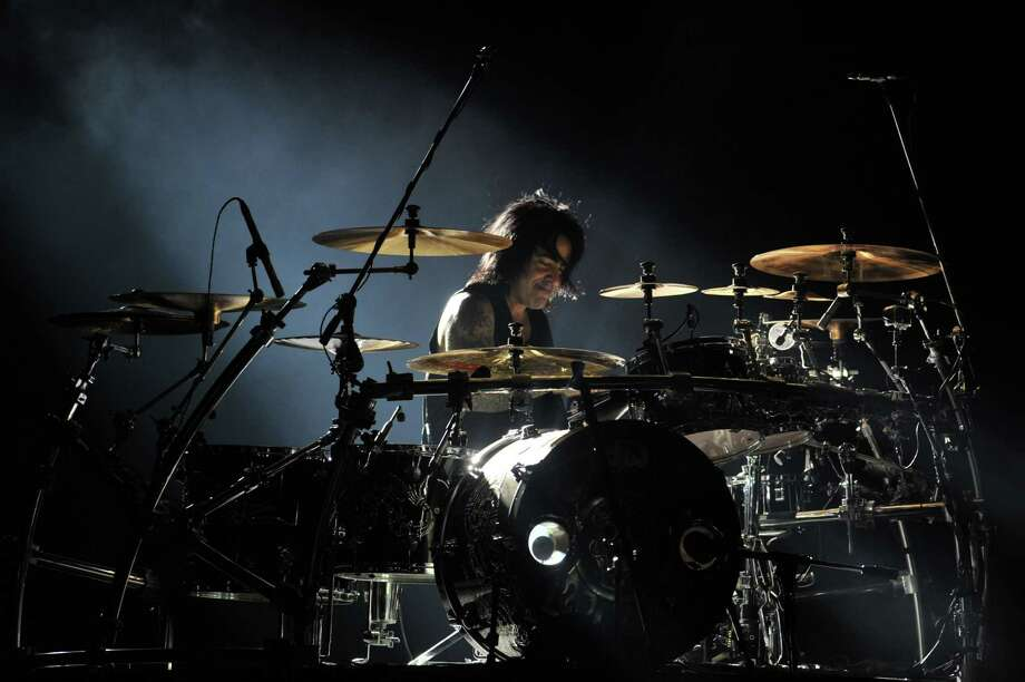 "The drummer for Mexican band Mana, Alejandro González, performs during the ""Drama y Luz"" World Tour at the National Footbal Stadium in Managua on March 16, 2013.    AFP PHOTO / Hector RETAMALHECTOR RETAMAL/AFP/Getty Images Photo: HECTOR RETAMAL, AFP/Getty Images / AFP"