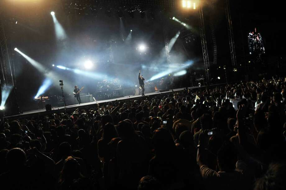 """Members of the Mexican band Mana perform during the """"Drama y Luz"""" World Tour at the National Footbal Stadium in Managua on March 16, 2013.    AFP PHOTO / Hector RETAMALHECTOR RETAMAL/AFP/Getty Images Photo: HECTOR RETAMAL, AFP/Getty Images / AFP"""