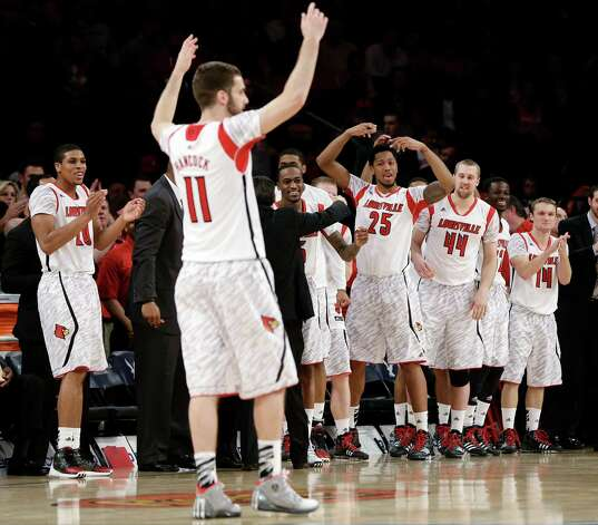 Louisville's Luke Hancock (11) and teammates celebrate late in the second half of an NCAA college basketball championship game against Syracuse at the Big East Conference tournament, Saturday, March 16, 2013, in New York. Louisville won 78-61. Photo: Frank Franklin II