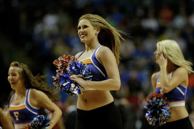 Florida  cheerleaders perform during the second half of an NCAA college basketball game against Alabama in the semifinals of the Southeastern Conference tournament, Saturday, March 16, 2013, in Nashville, Tenn. (AP Photo/John Bazemore) Photo: John Bazemore, Associated Press / AP
