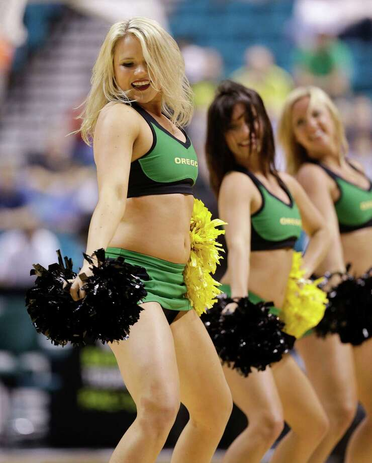 Oregon cheerleaders perform during a semifinal Pac-12 tournament NCAA college basketball game against Utah, Friday, March 15, 2013, in Las Vegas. (AP Photo/Julie Jacobson) Photo: Julie Jacobson, Associated Press / AP